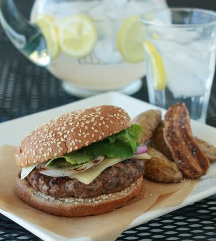 These are the best hamburgers EVAH! The beef is mixed with sour cream and fresh herbs and topped with grilled red onions. The sour cream gives the meat a cool flavor and the herbs add a bright, fresh taste.