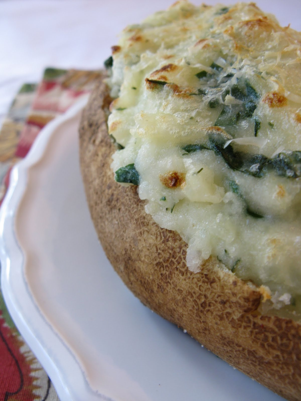 These twice baked spinach potatoes are my go-to side dish! And best of all, they are freezable!