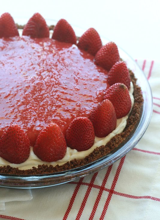 A graham cracker crust filled with sweet cheesecake and topped with strawberries makes for a delicious strawberry pie.