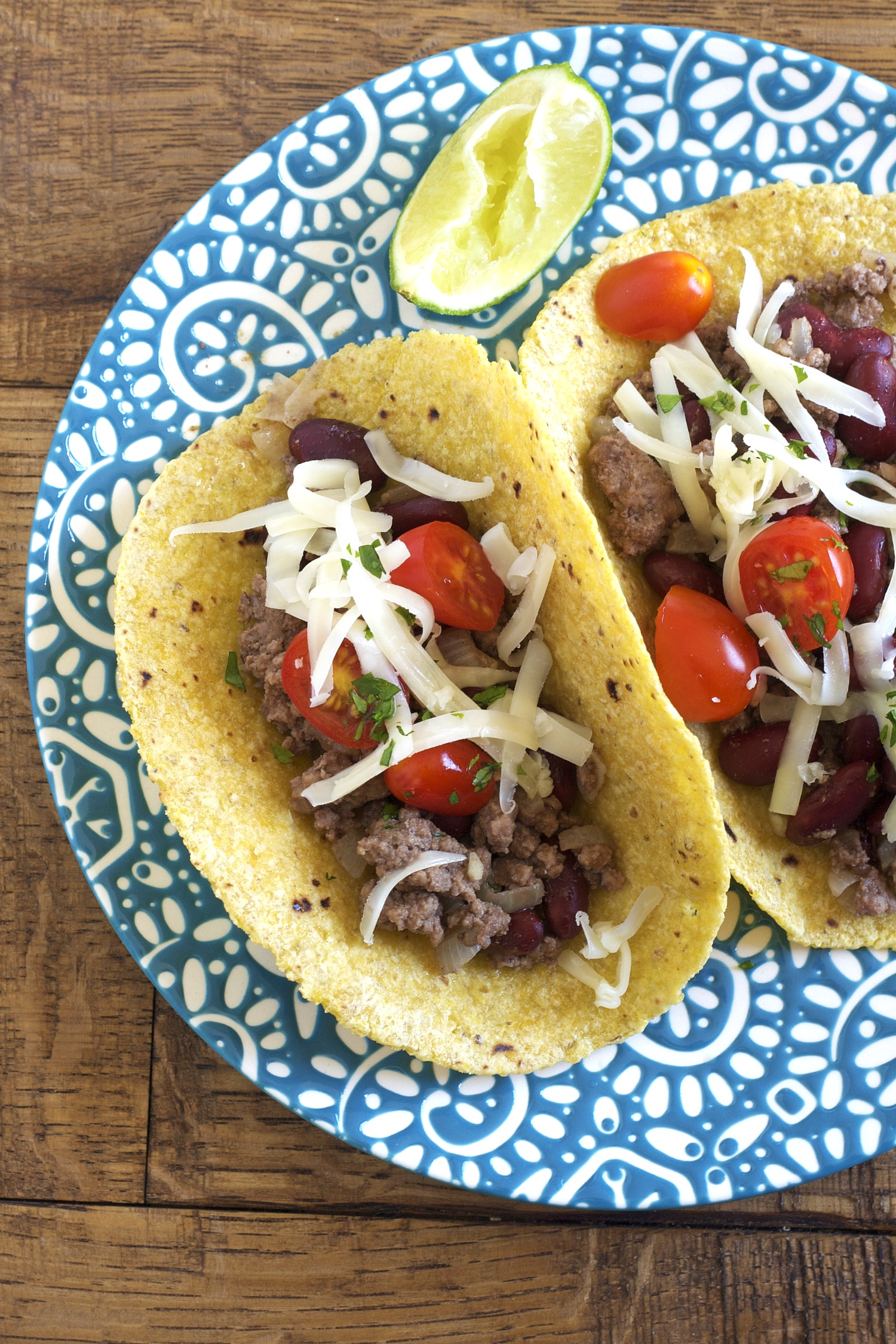 Stretch your real food budget by adding beans to your beef in these beef tacos!