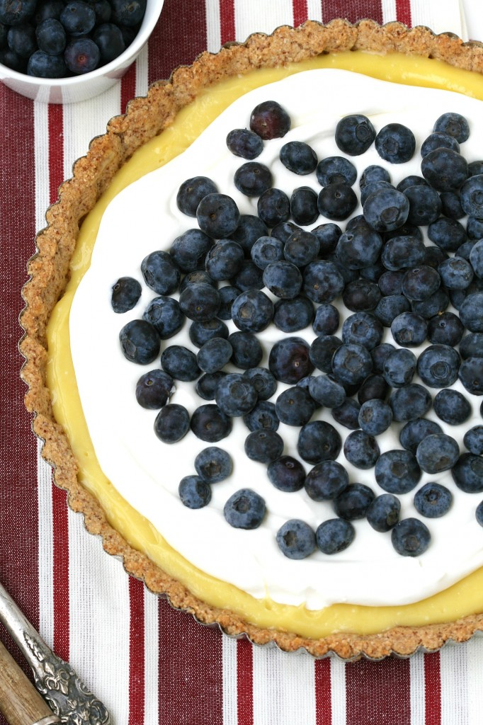 A grain-free lemon tart with a cookie-shortbread crust, whipped cream and berries sounds amazing!