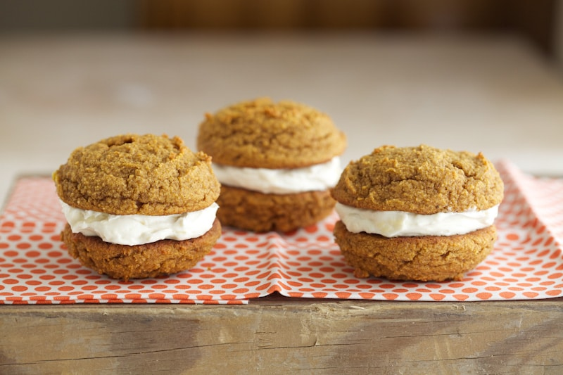These pumpkin whoopie pies make for a great spongy cookie on their own - the cookies almost taste a bit like muffin tops. Two spiced cookies are paired together with whipped butter, cream cheese and maple syrup to sweeten. They are quite the treat.