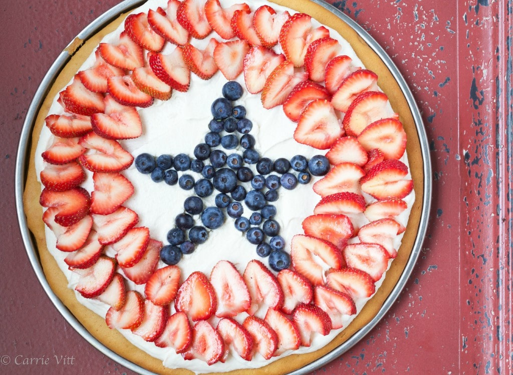 I love making fruit pizzas as a sweet treat! With the creamy-vanilla topping, beautiful berries and sweet crust, I've never met anyone who could resist a slice.