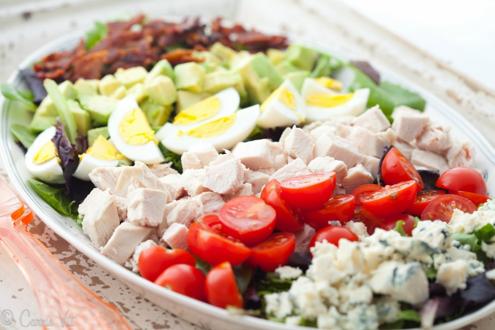 Cobb salad makes for an incredibly filling, classic staple. While some recipes call for a fancy vinaigrette, I like to keep it simple with my favorite - the juice of one lemon, a few 'glugs' of olive oil, sea salt and freshly ground black pepper.