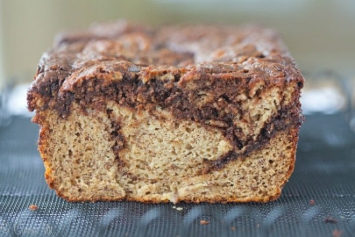 This chocolate swirl paleo banana bread recipe is easy to make and supports many creative variations. You can omit the chocolate swirl and stir in nuts, berries or dried fruit. It makes for a great breakfast or mid-day snack.