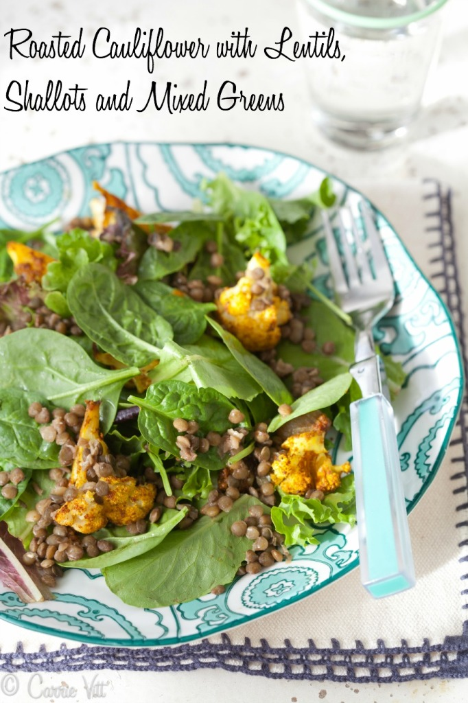 Roasted and spiced cauliflower and shallots are roasted and mixed with lentils, and mixed greens to make this delicious salad!