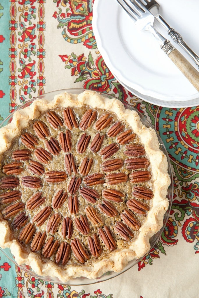 Chocolate pecan pie with bourbon is a fun way to take pecan pie up a notch or two. It's an impressively delicious dessert that isn't complicated to make.