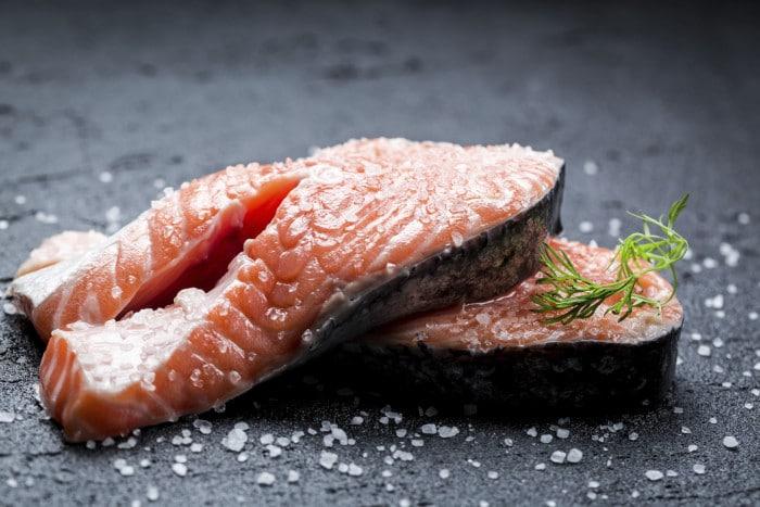 Fresh raw salmon with coarse salt