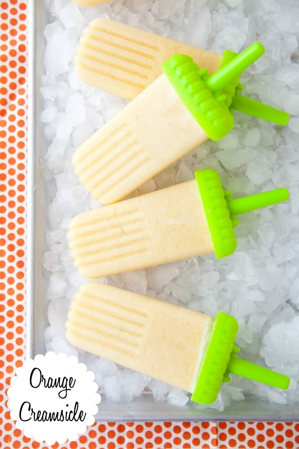 It only takes 3 ingredients to make these orange creamsicle popsicles! And they're paleo, too.