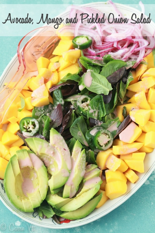 Cut the mango and avocado into bite-sized pieces, layer them with baby romaine, drizzle with jalapeño vinaigrette and top it all off with the pickled onions
